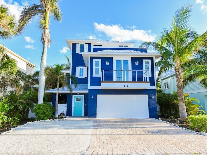 Amazing home with WATERSLIDE! One Block off beach! Life is Just Beachy here!
