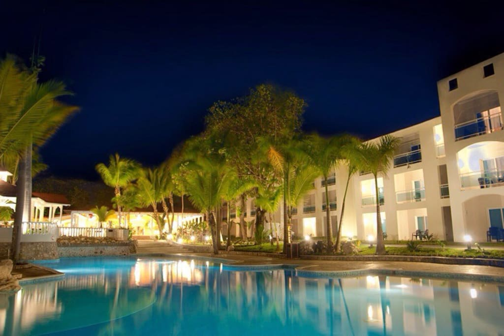 Exterior of the building, the beach is just across the pool!