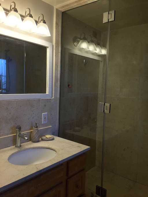 Newly remodeled bathroom with beautiful marble tiles