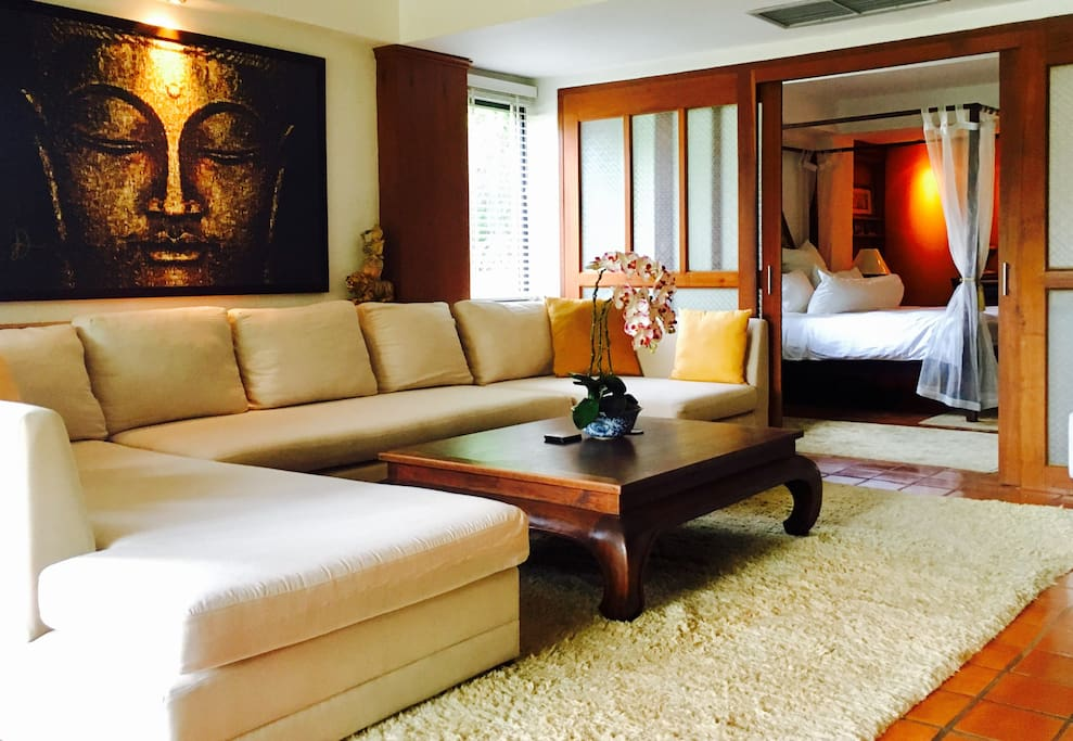 Elegant Thai living with reclaimed teak furniture and Jim Thompson silk accents.