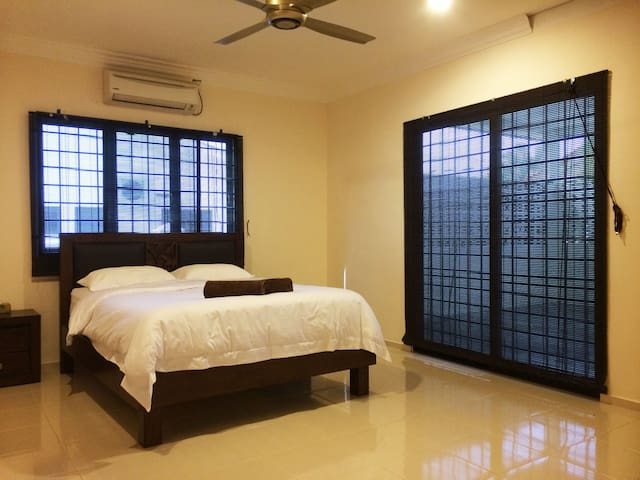 Spacious Ensuite Master Bedroom with door onto enclosed private terrace