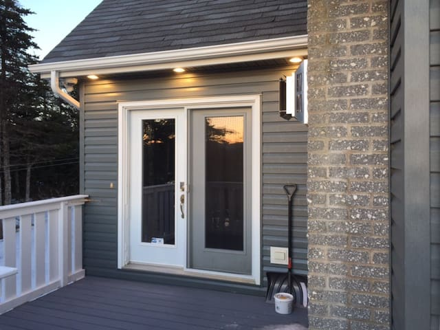 Suite Private Entrance with deck, BBQ and small table and chairs.