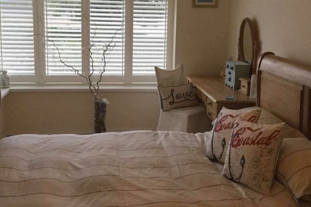 Spacious bedroom with ample storage, king size bed and sea views!