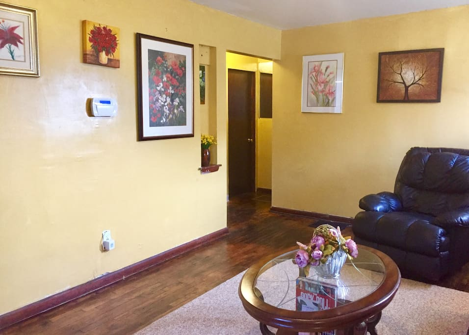 Colorful & cheerful home with beautiful paintings and decorations.