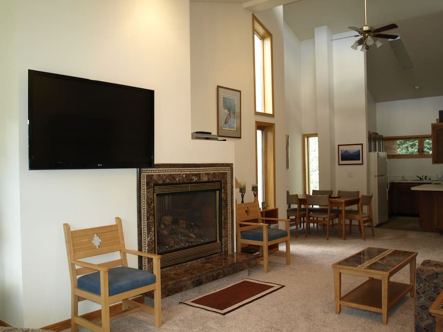 "Expansive great room, 55"" TV & fireplace"