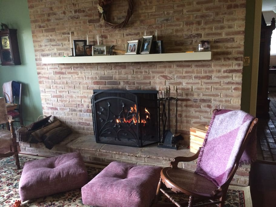 Curl up by a cozy fire with a book from the family library.