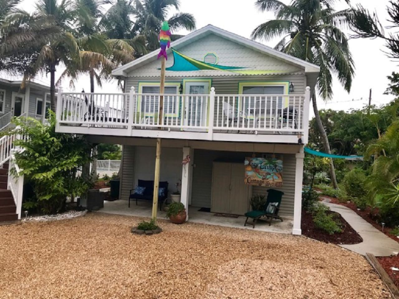 Shading sails of bright blue and green brighten the upper deck of Island Life Suite. A colorful fish wind sock lets you know which way the wind is blowing...fun day ahead! Relax on the chaise lounge or grill on the gas grill and dine el fresco.