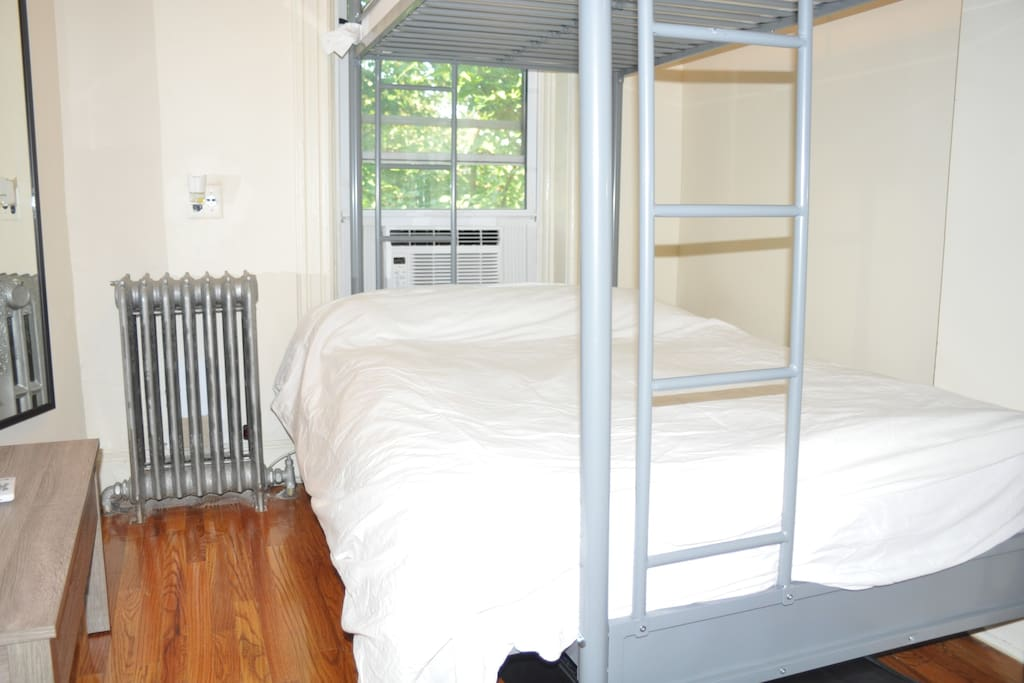 Full size double bed for 2 and top bunk for 3rd person, both with highly rated mattresses.