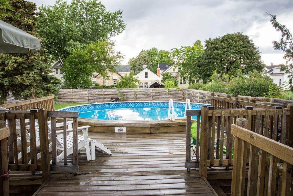 Outside deck, pool, and backyard.