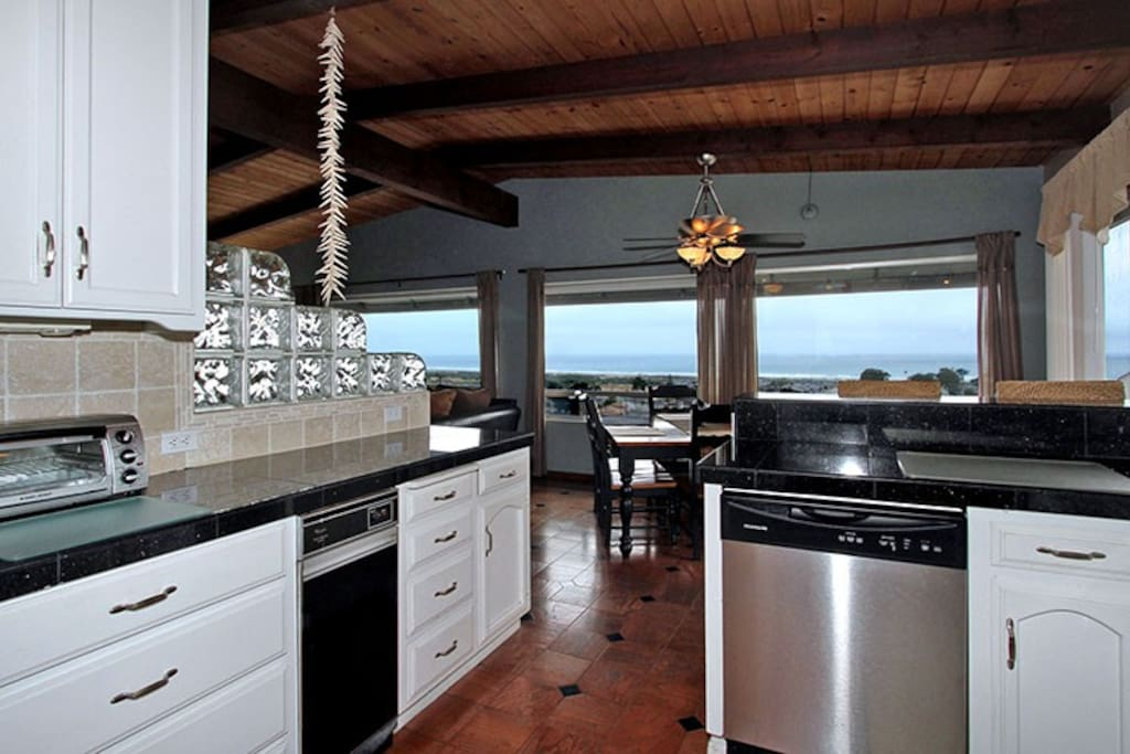 Kitchen with ocean views. Watch the whales go by as you dine at the table!