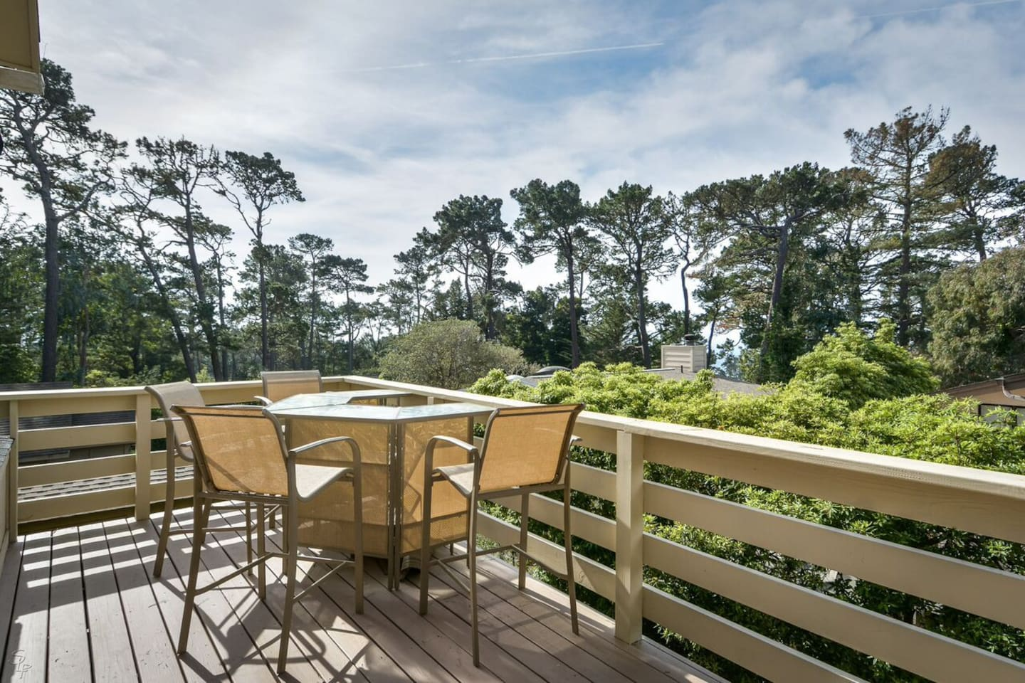 Welcome to Sandy Toes Cottage - Dining balcony with Gas BBQ and distant ocean view.