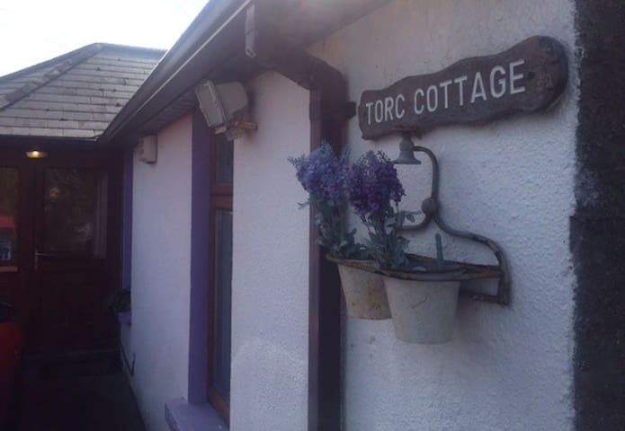 Torc Cottage is located just off Church Road