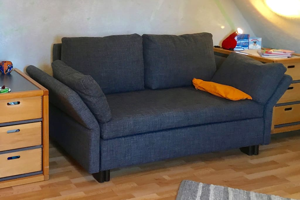 That's your bed sofa! Easy to re-arrange for the night, comfortable for 2 people - or just sleep like that if your a small single person.