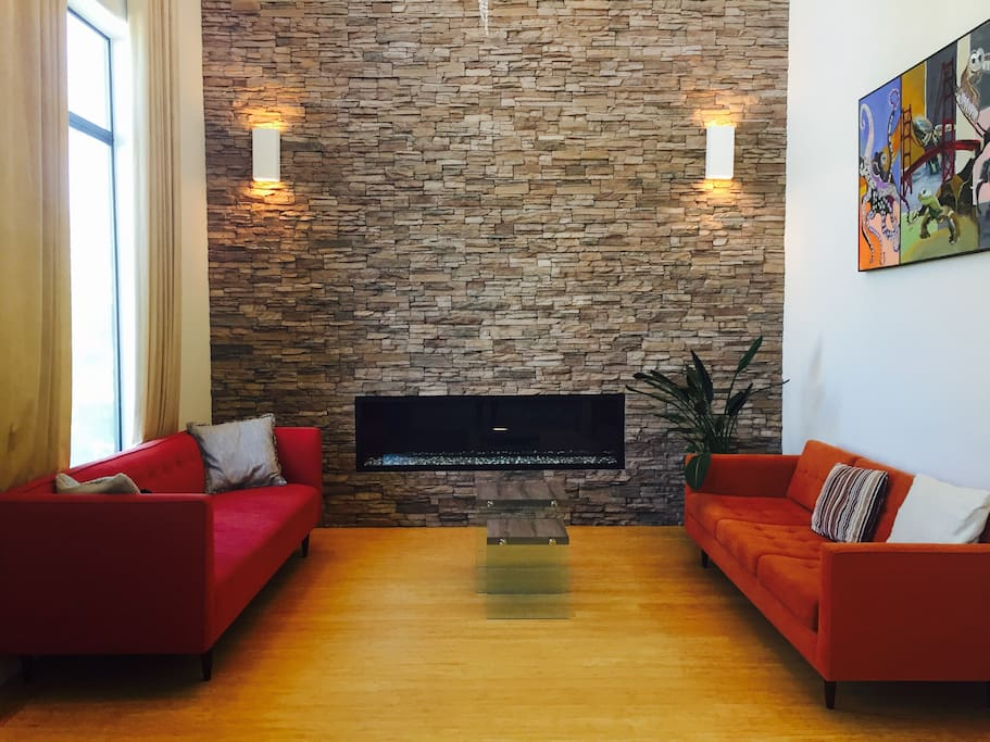 High ceiling living room with ventless fireplace