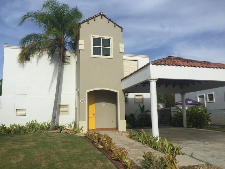 Golf & beach house with a pool