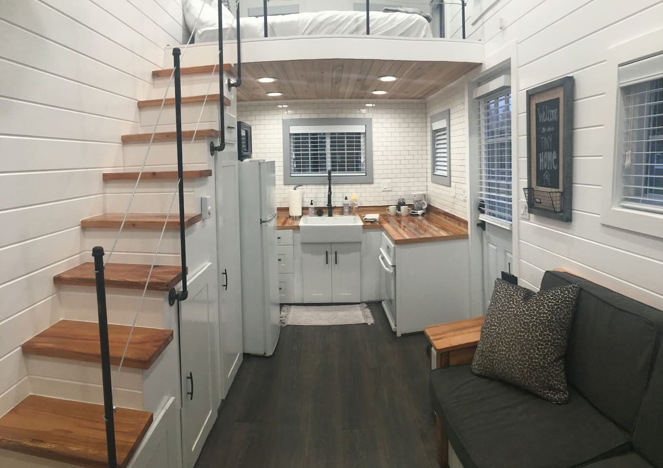 Up the stairs is a Loft with a Full size Mattress (sleeps 2). Under you'll find kitchen stocked with coffee, dishes, and even a full-size oven!