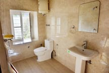 A clean washroom for both the rooms.