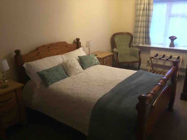 Double bedroom, which has large wardrobe, dressing table, armchair and luggage rack