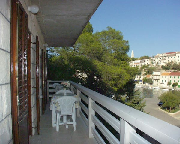 Three bedroom apartment with terrace and sea view Povlja (Brač) (A-716-a)