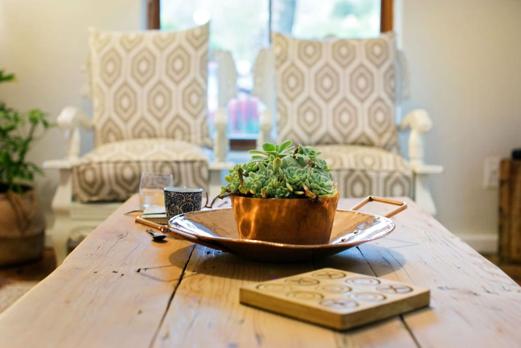 Our two South African ball and claw chairs. The decor throughout the house is simplistic, natural and practical.