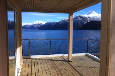 House touching the fjord - Stranda