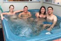 Guests enjoying the backyard spa!