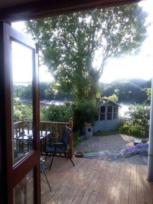 Deck and garden from the living room. Alfresco eating with great views! Plenty of garden furniture in the summerhouse