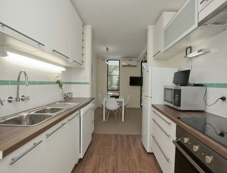 Fully equipped kitchen with oven, microwave, stove, dishwasher and tea, coffee, sugar and milk to get you started.