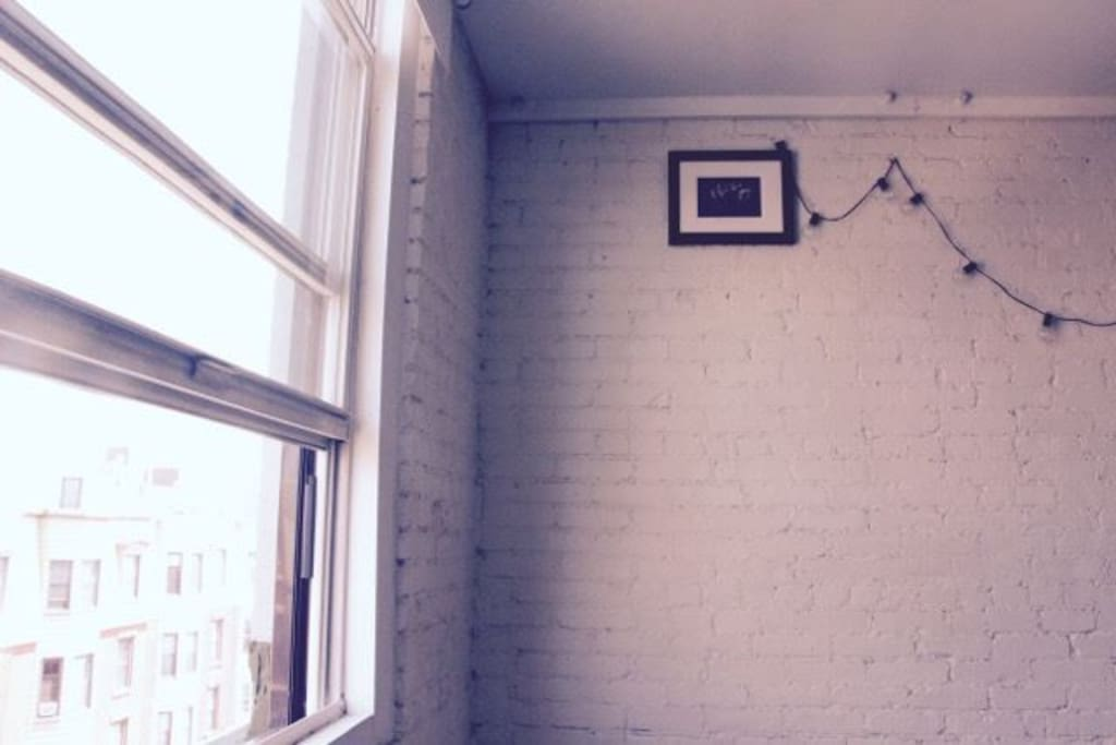 Room features a real brick wall and cute details, and get the morning sun :)