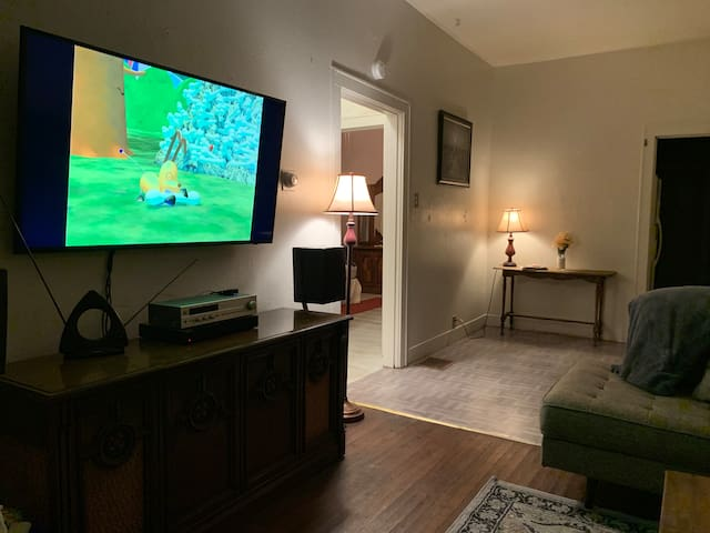 """Night shot of entertainment center with Bluetooth stereo and 55"""" smart TV"""