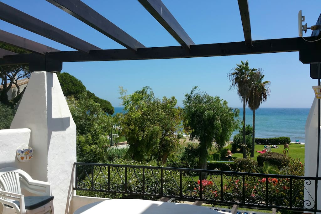 Enjoy sea views from the balcony, lounging around the big, patio table (seats up to 8 people). Retractable shade coverage available.