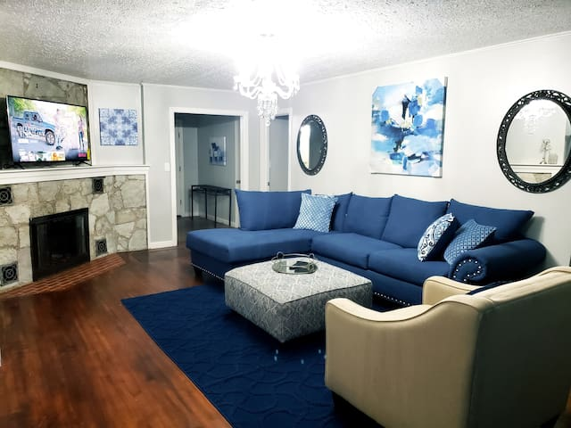 Upstairs living room with comfy sectional sofa, ottoman, and chair. 60in 4k Smart Tv with access to all streaming networks like Netflix, hulu, youtube, etc.
