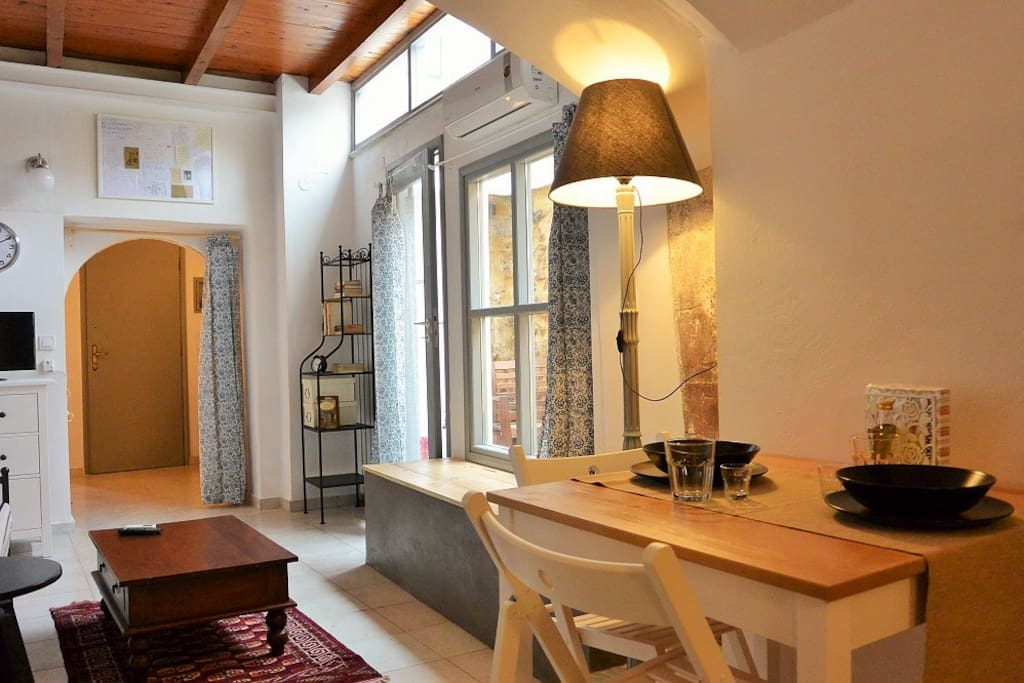Two preserved Venetian stone arcs divide physically the studio in  three rooms: bedroom, living room and a kitchen
