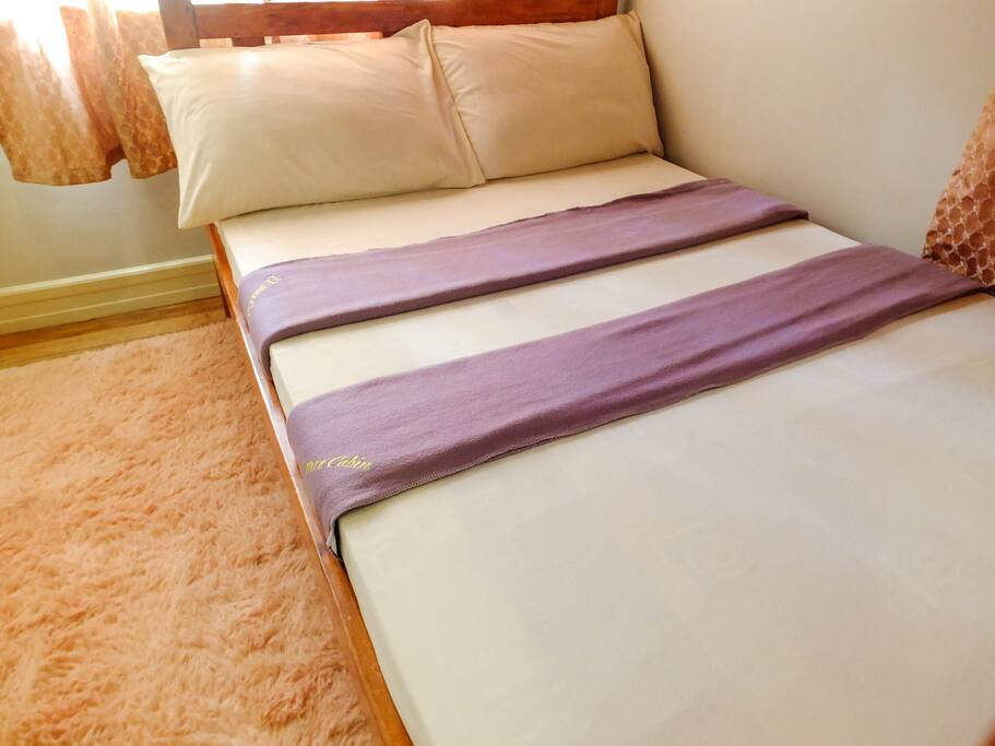 Beds are fitted with hotel-class bedsheets, blankets and pillows.