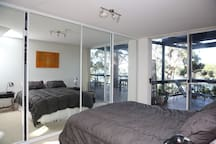 Queen bedroom with direct access to the deck