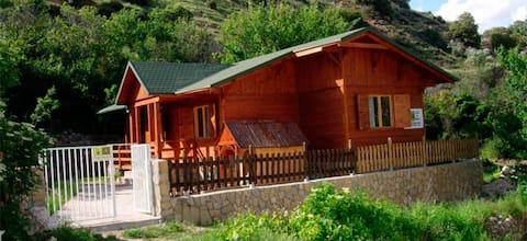 Wooden farmhouse in nice quiet village