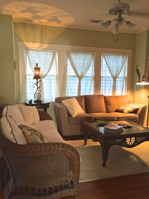 LIVING RM. Comfortable and intimate, watch TV, listen to music or visit with family/friends. Ceiling fans keep you cool in the summer.