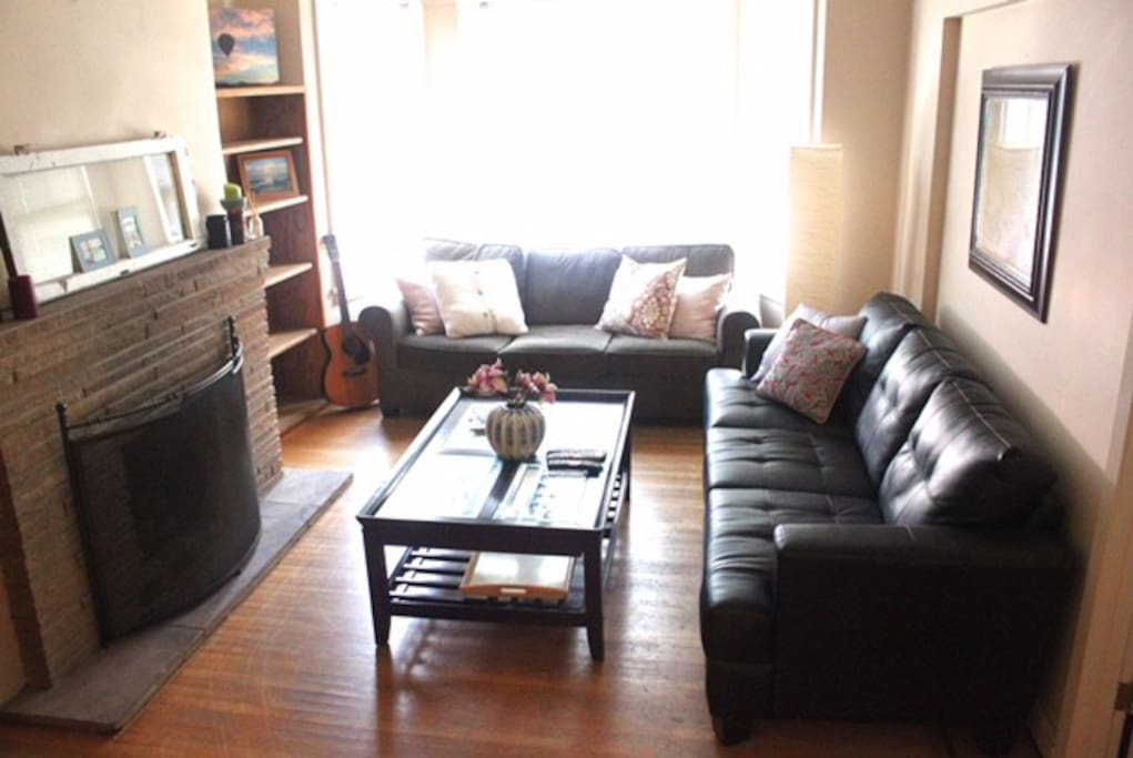 The living room with couches and TV.