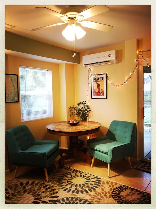 UPDATE: We  replaced the wooden chairs with comfy chairs for the table  to make this space better for relaxing.