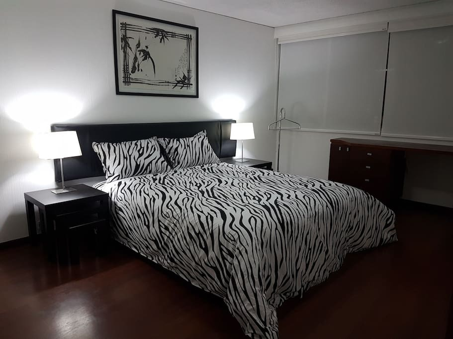 Master bedroom with Queen sized bed, night tables and desk!