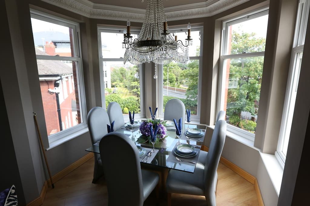 the dining table is in the bay set for 6 people (will sit 8)