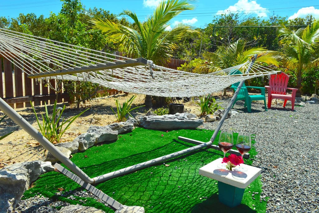 Backyard relaxation chairs and chaise loungers - Poinciana Place Providenciales Turks and Caicos Islands