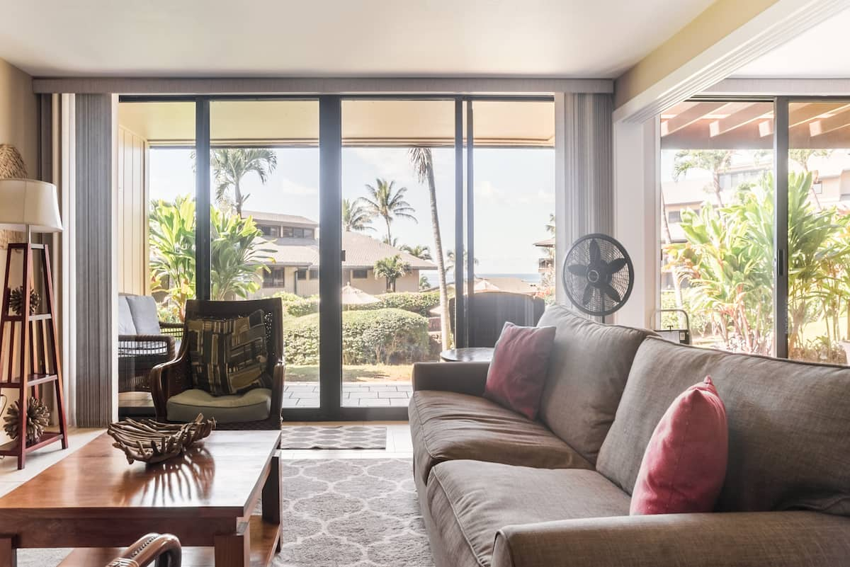 Walk to the Beach from Stylish Condo. Central Air Included