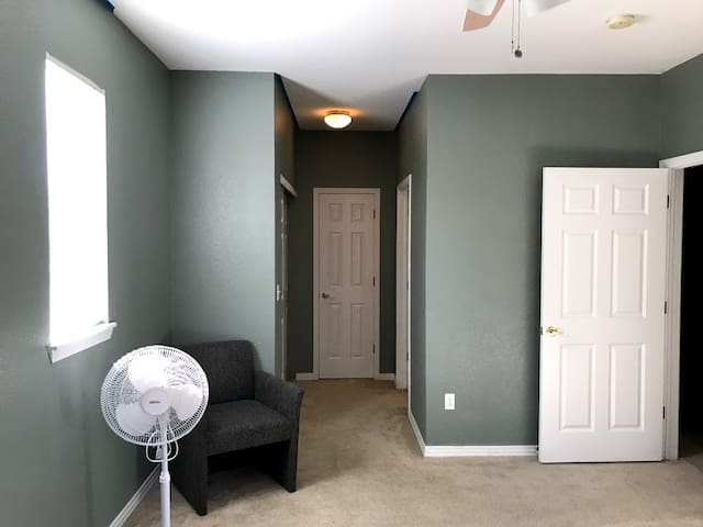 The room features two closet for guest to store items