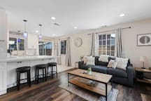 Open concept living space with large peninsula. We have a 3 piece kitchen table as well (not pictured).
