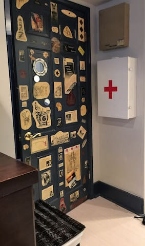 This art came from projects I finished during my first 10 years in business. I worked another 15 years after that but ran out of room on the door.  The first aid kit is fully stocked.
