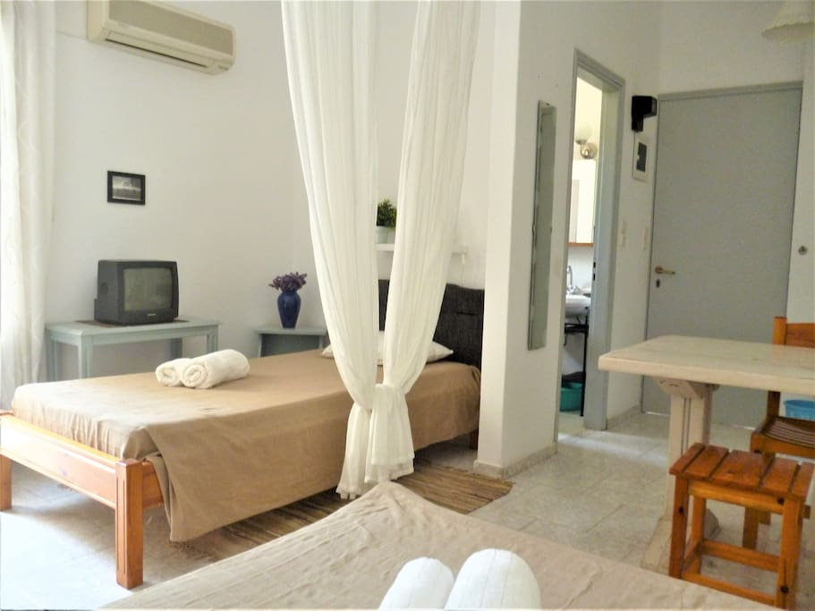 Night area, single bed and double bed separated by a white curtain