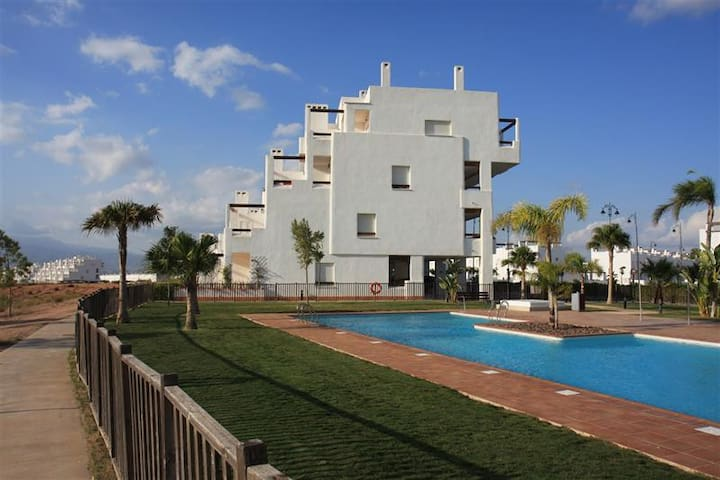 Wonderful corner penthouse with pool and golf!