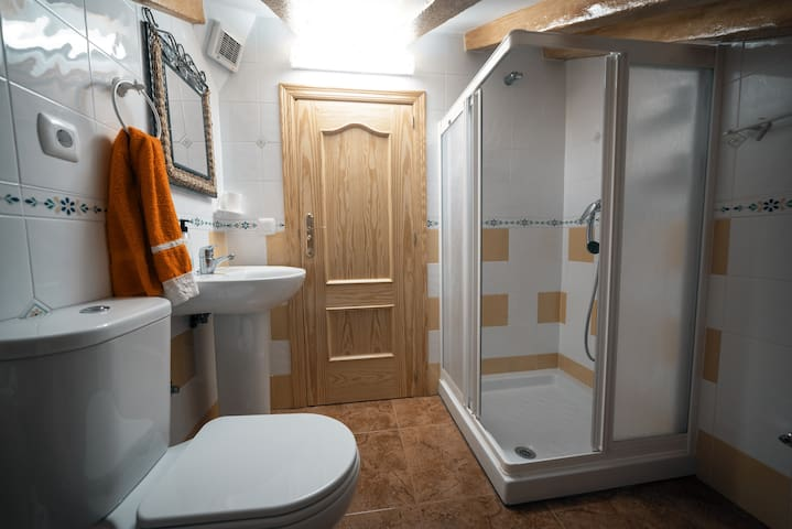 Your private bathroom. It has low ceiling! Anyone taller than 1,80 might have to duck.