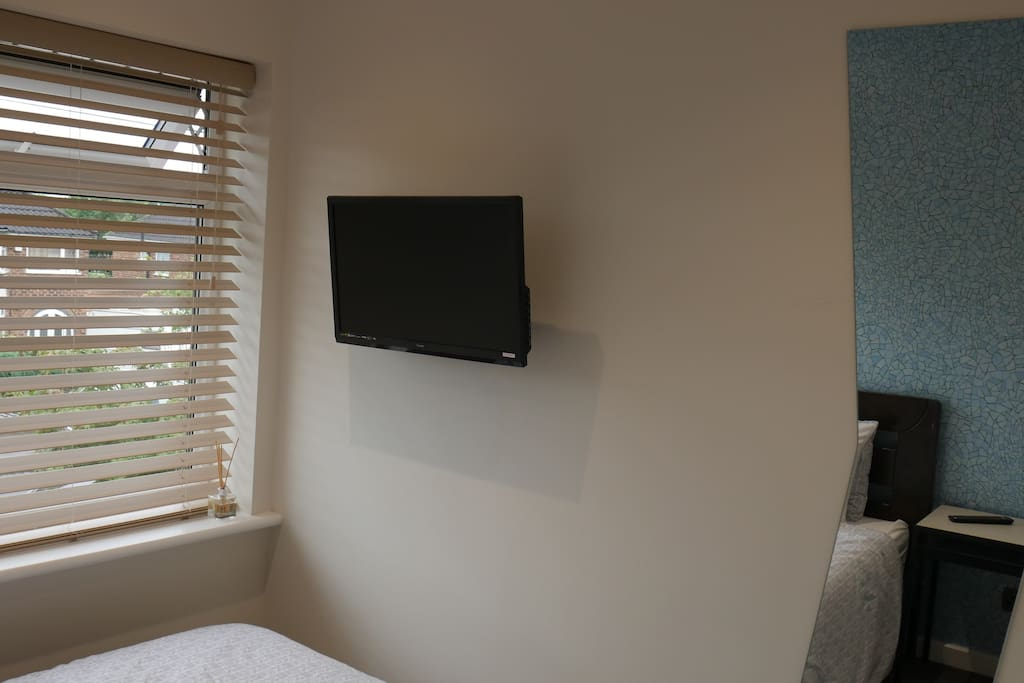 Nec Birmingham home with Single bedded room with wall mounted Smart tv